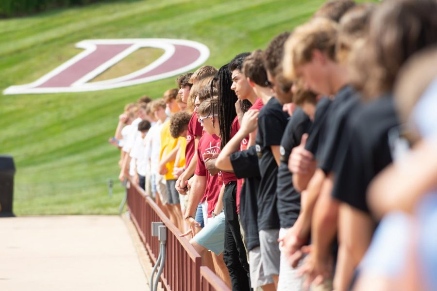 Students stand to welcome the clergy to begin the Mass of the Holy Spirit. The Mass of the Holy Spirit is the first all-school mass of the school year, and is celebrated by Jesuit high schools and colleges around the world at the beginning of the school year.