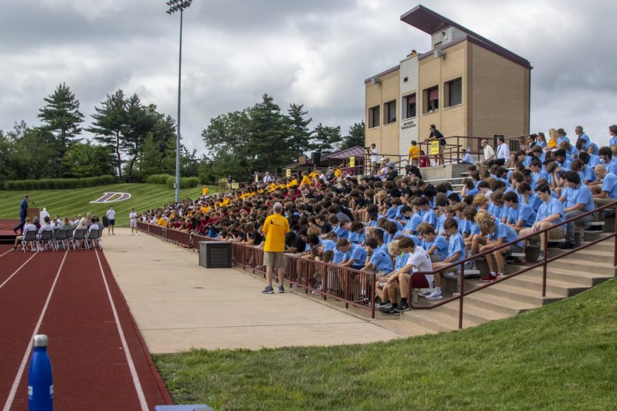 The+student+body+listens+as+president+Daniel+Zepp+gives+his+opening+remarks+before+the+start+of+the+Mass+of+the+Holy+Spirit.+The+students+were+seated+with+their+house%2C+wearing+their+house+colors.+More+events+this+year+will+feature+the+house+system.