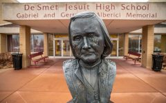 The statue of Fr. Peter De Smet greets students as they enter the school each day. Students will have eight days this year when school will start 40 minutes later to give leaders of clubs and activities time to plan various events.