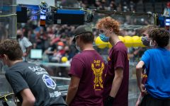 Austin York 22 and Thomas Schuster 21 look into the arena during the GRC Robotics. Competition